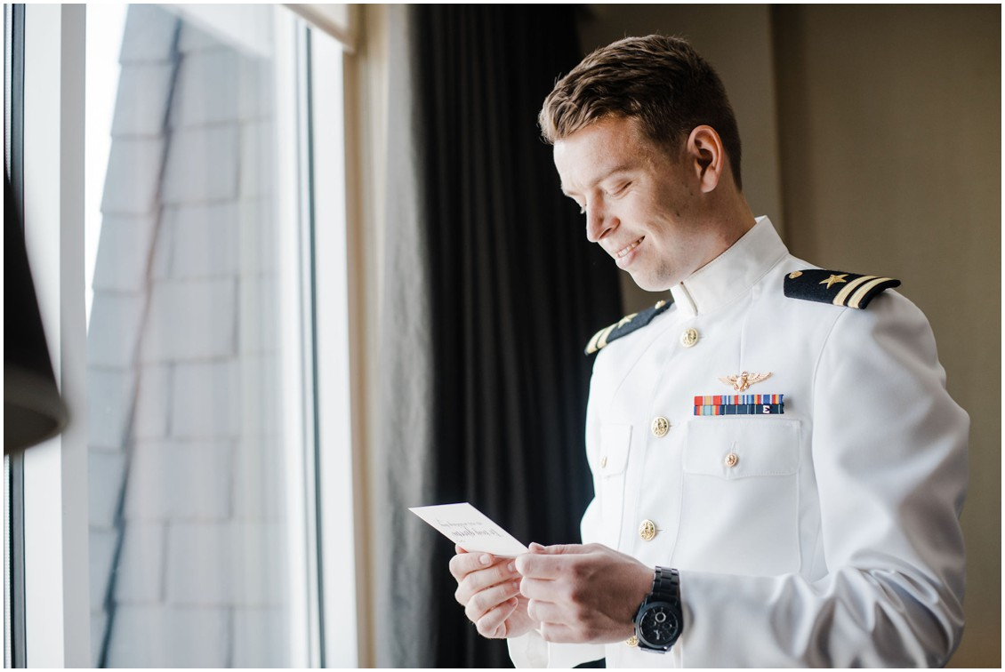 Groom in naval uniform reading note  | My Eastern Shore Wedding | Chesapeake Bay Beach Club