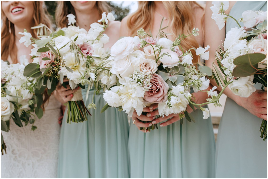 Bridesmaids with dusty rose and white bouquets against sage green dresses  | My Eastern Shore Wedding |