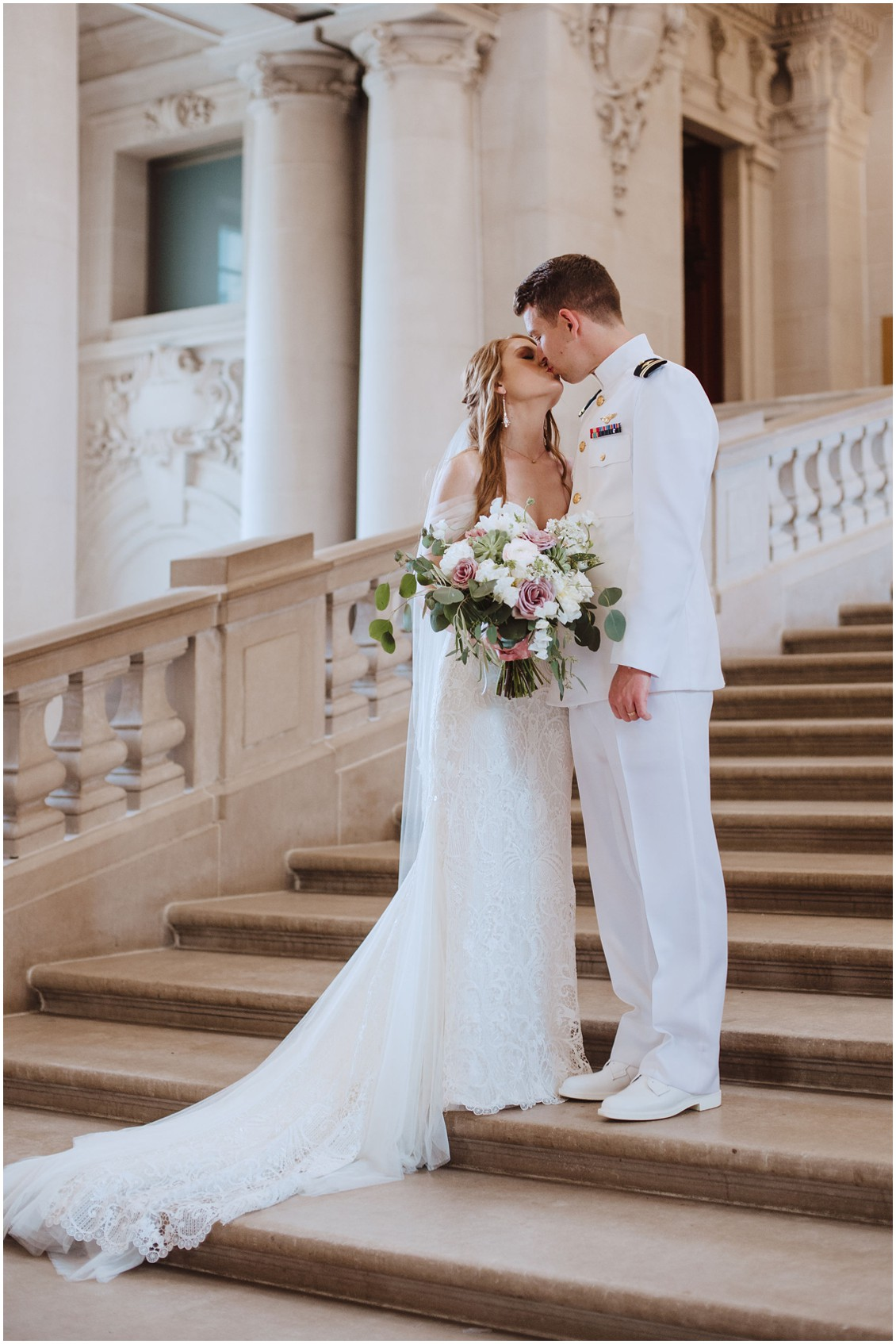 Bride and groom kissing on steps of US Naval Academy Chapel  | My Eastern Shore Wedding |