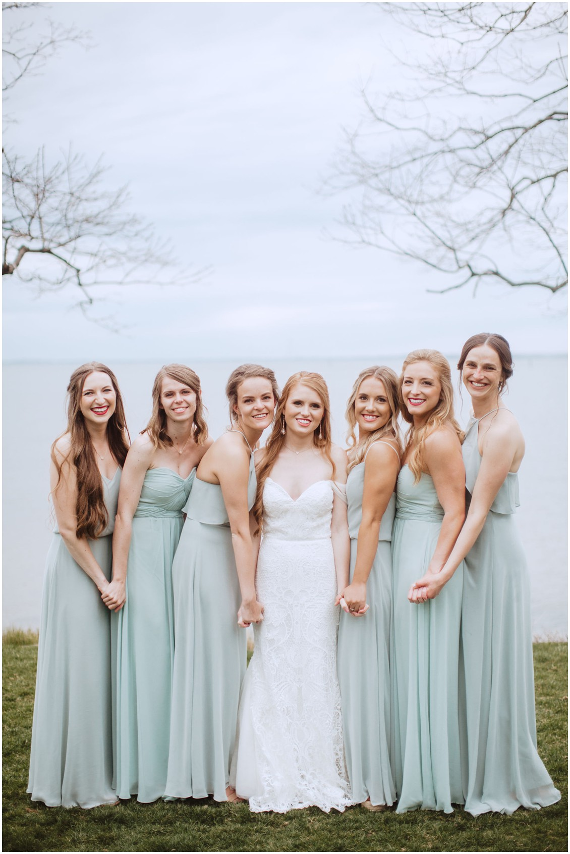 Bride with bridesmaids in sage green dresses around sunset| My Eastern Shore Wedding | Chesapeake Bay Beach Club
