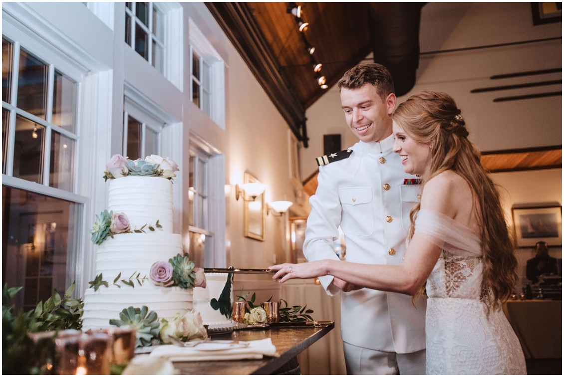 Bride and groom in sailor uniform cutting cake with naval sword | My Eastern Shore Wedding | Chesapeake Bay Beach Club