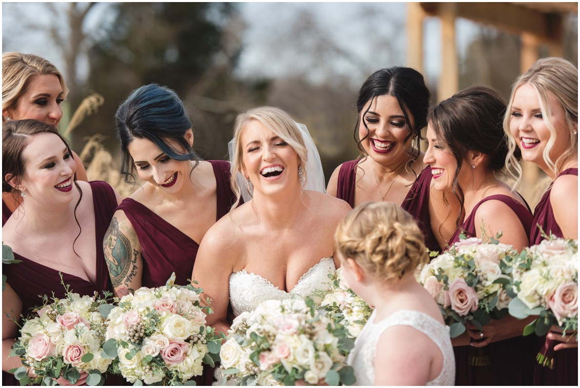 Bride laughing surrounded by bridesmaids in burgundy | My Eastern Shore Wedding | Karena Dixon | Monteray Farms