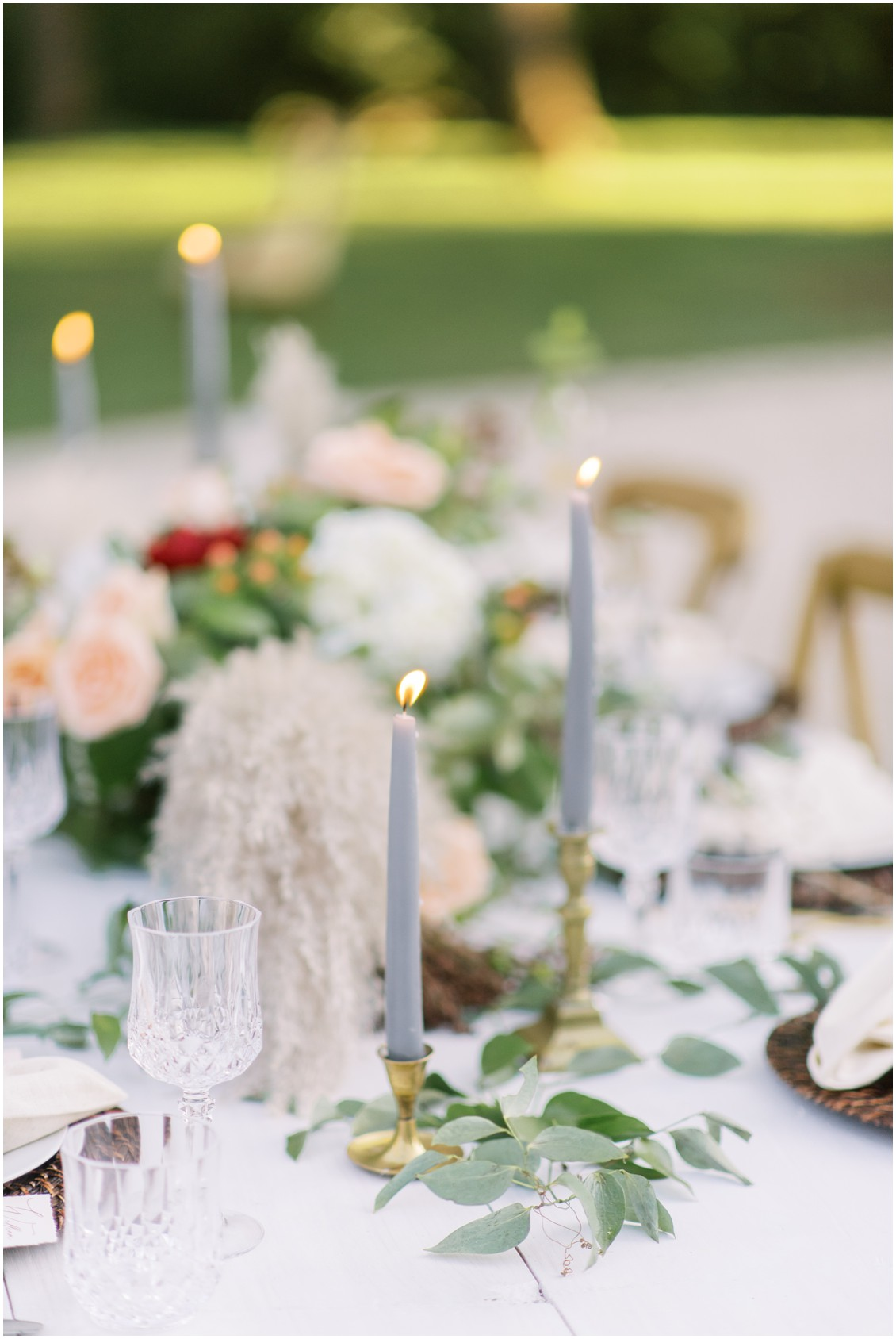 Detail of tablescape with greenery and grey tapered candles| My Eastern Shore Wedding | Hannah Belle Events | Eastern Shore Tents and Events