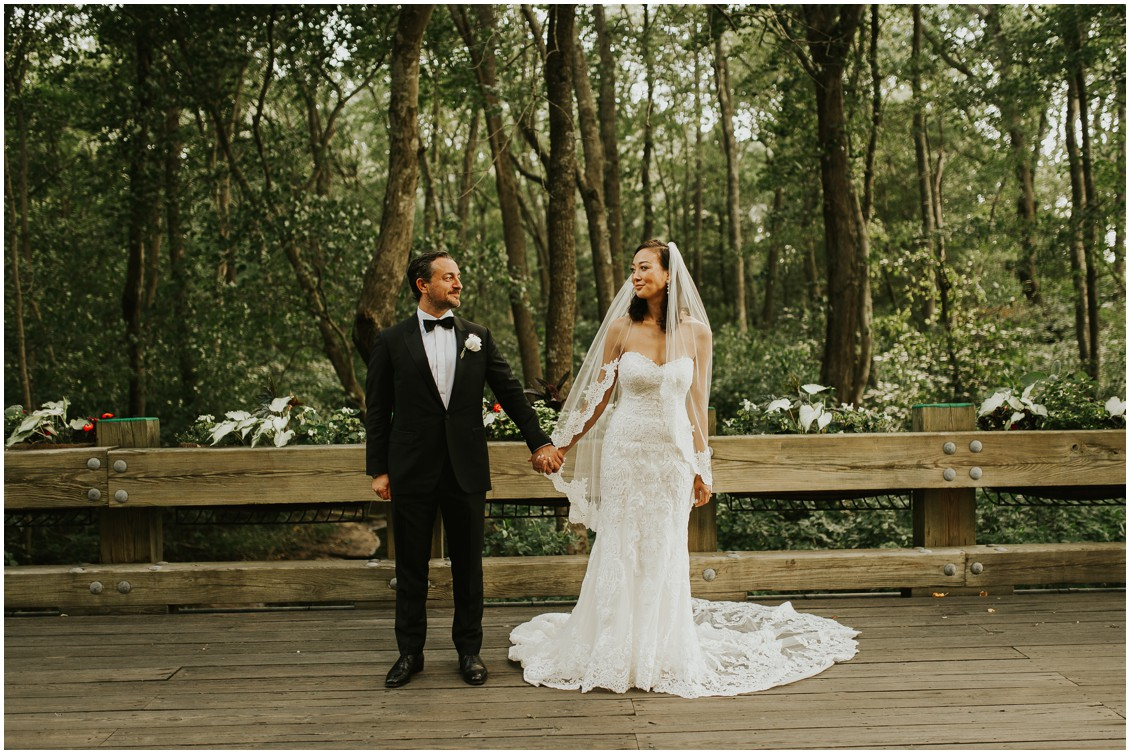 Bride and groom holding hands looking at each other | My Eastern Shore Wedding