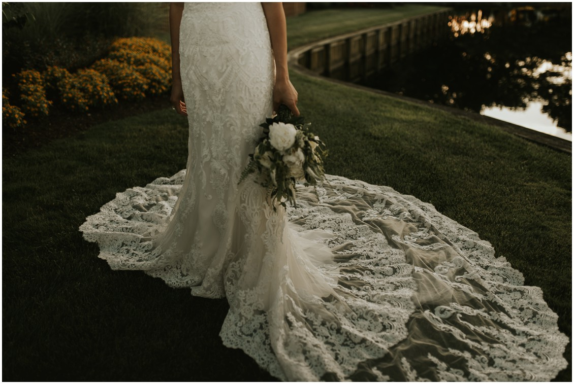 Detail of lace bridal gown, train and bouquet | My Eastern Shore Wedding