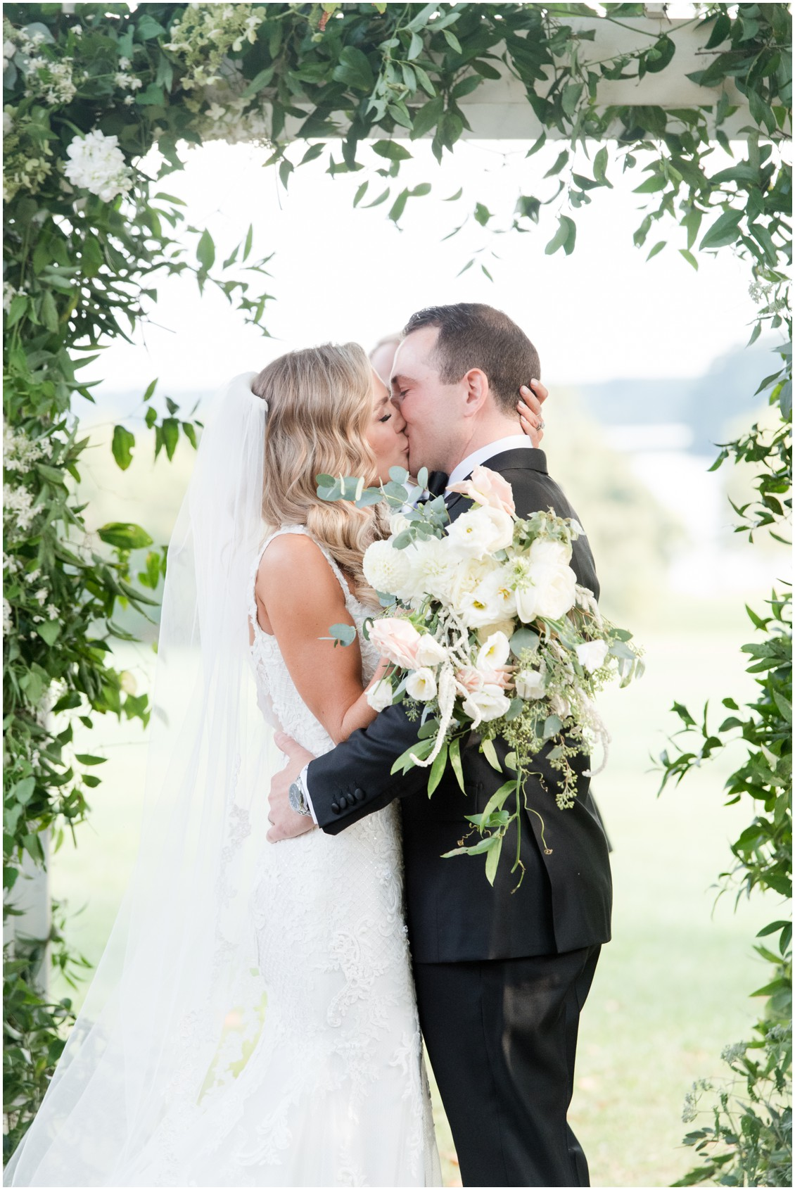 Bride and groom first kiss | Brittland Manor | Rob Korb | My Eastern Shore Wedding