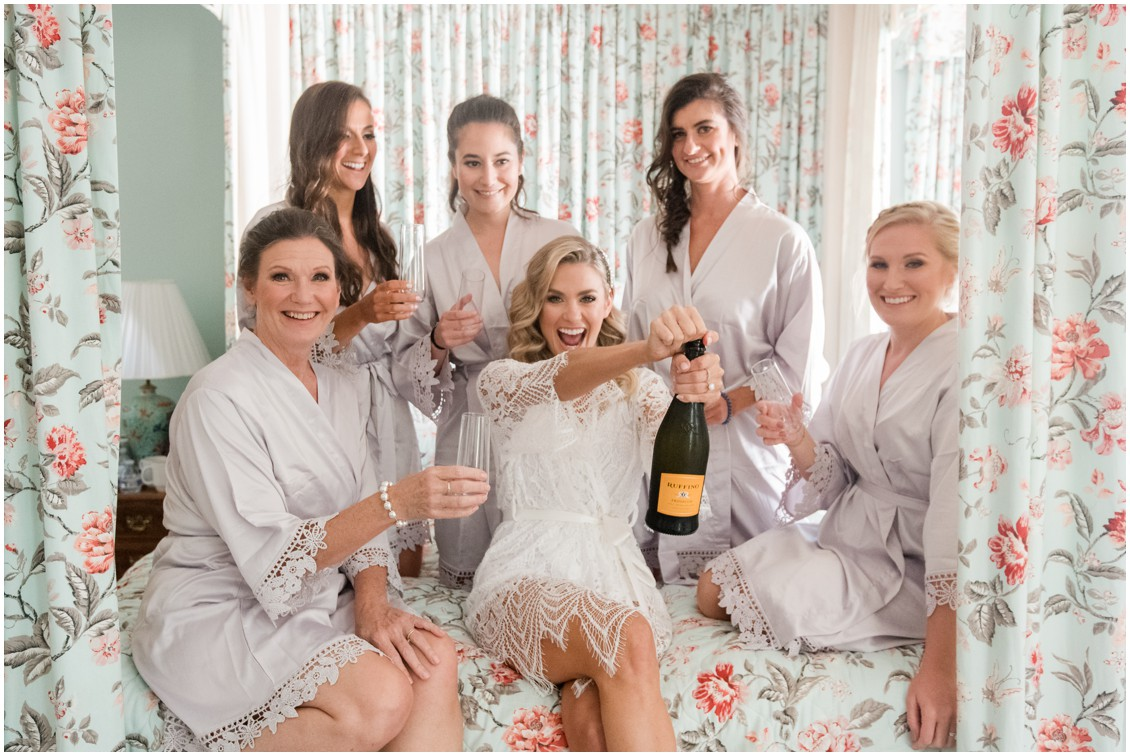 Bridal party opening champagne getting ready | Brittland Manor | Rob Korb | My Eastern Shore Wedding