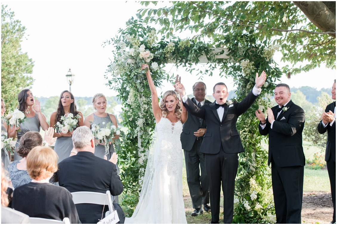 Bride and groom celebrating after ceremony | Brittland Manor | Rob Korb | My Eastern Shore Wedding
