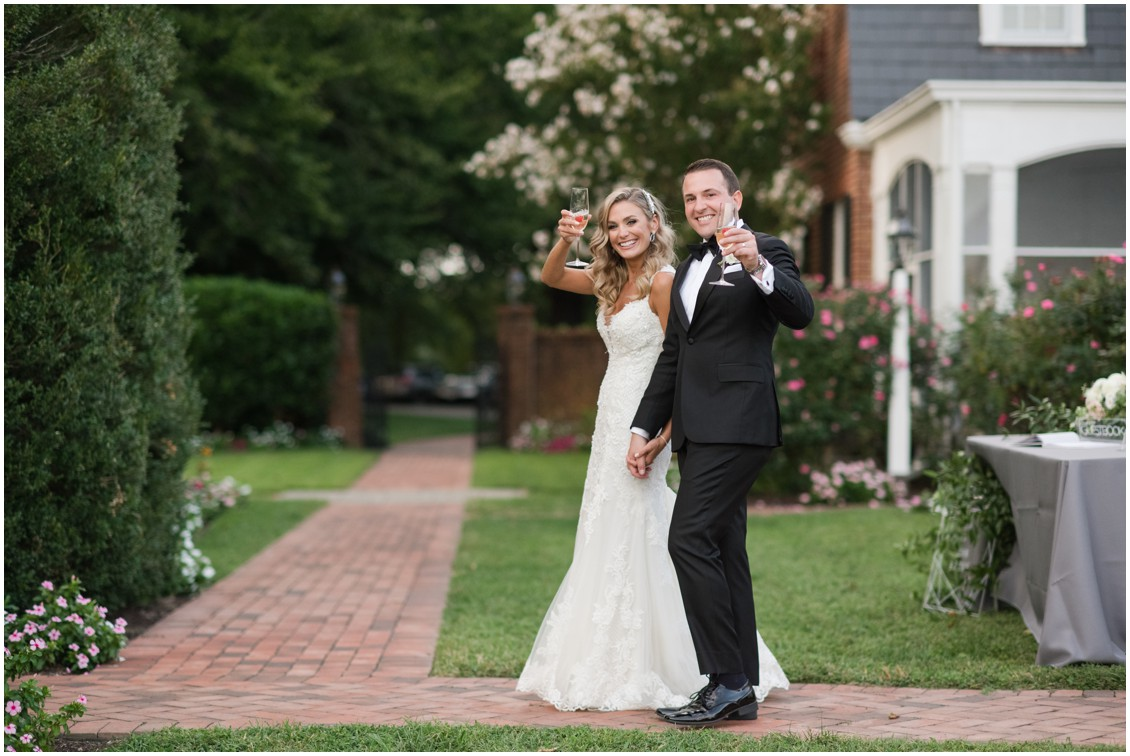 Bride and groom celebrating after ceremony holding champagne | Brittland Manor | Rob Korb | My Eastern Shore Wedding