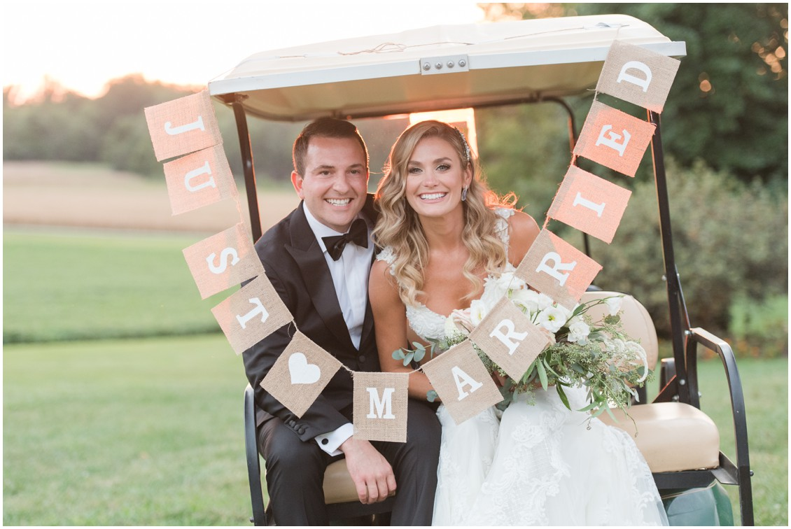 Bride and groom portrait on golf cart with just married sign | Brittland Manor | Rob Korb |  My Eastern Shore Wedding