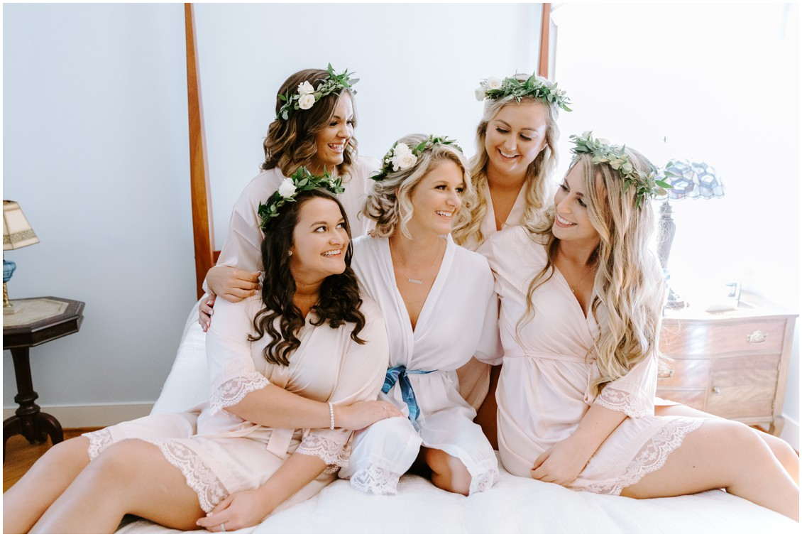 Bride and bridesmaids with soft green floral crowns in matching robes  | My Eastern Shore Wedding | Sherwood Florist