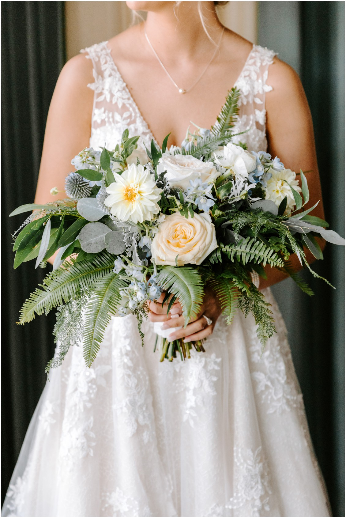 Bride holding bouquet details demure blue and soft greenery | My Eastern Shore Wedding | Sherwood Florist