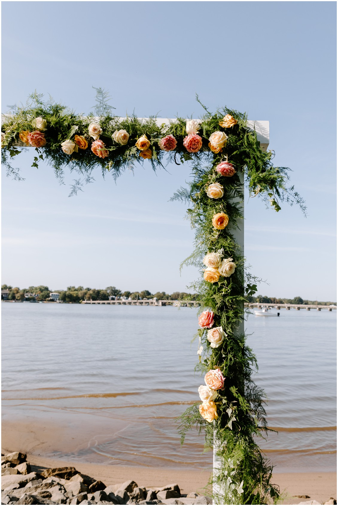 Detail of arch with soft greenery and roses| My Eastern Shore Wedding | Sherwood Florist | Eastern Shore Tents and Events