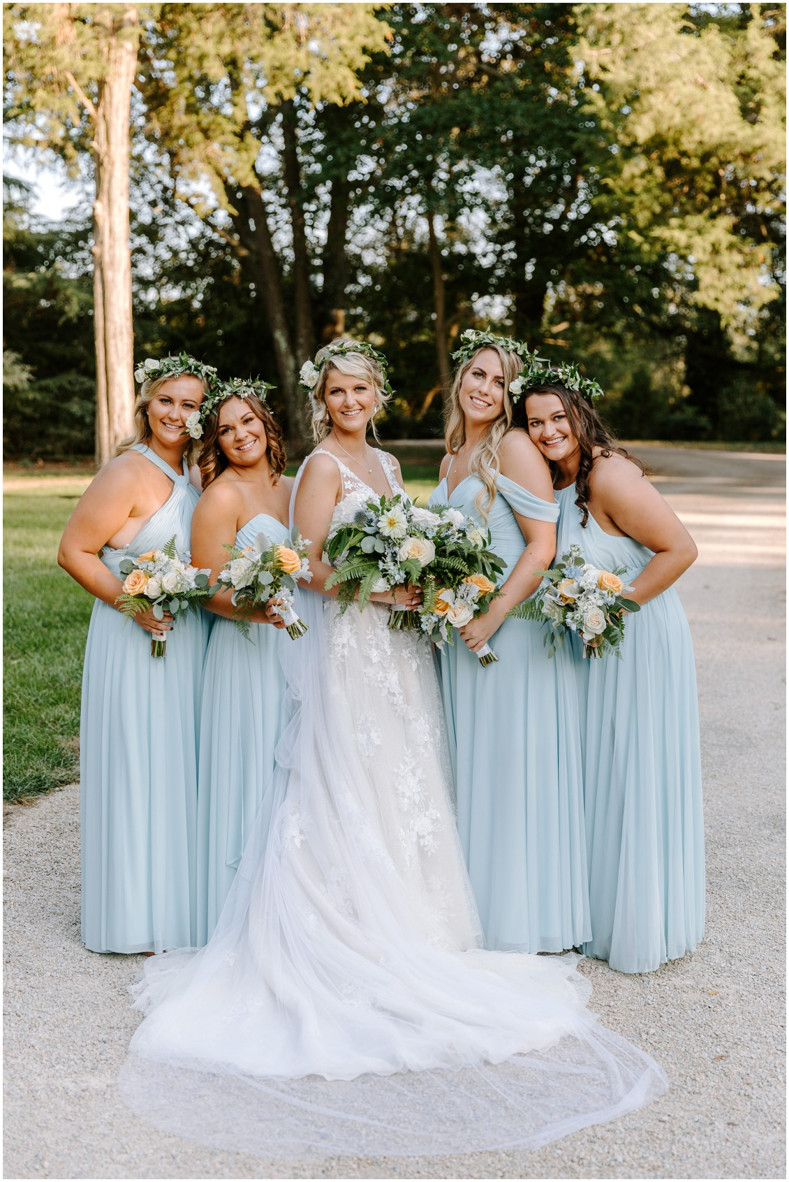 Bride with bridesmaids in soft blue dresses with pops of peach| My Eastern Shore Wedding | Sherwood Florist | Eastern Shore Tents and Events