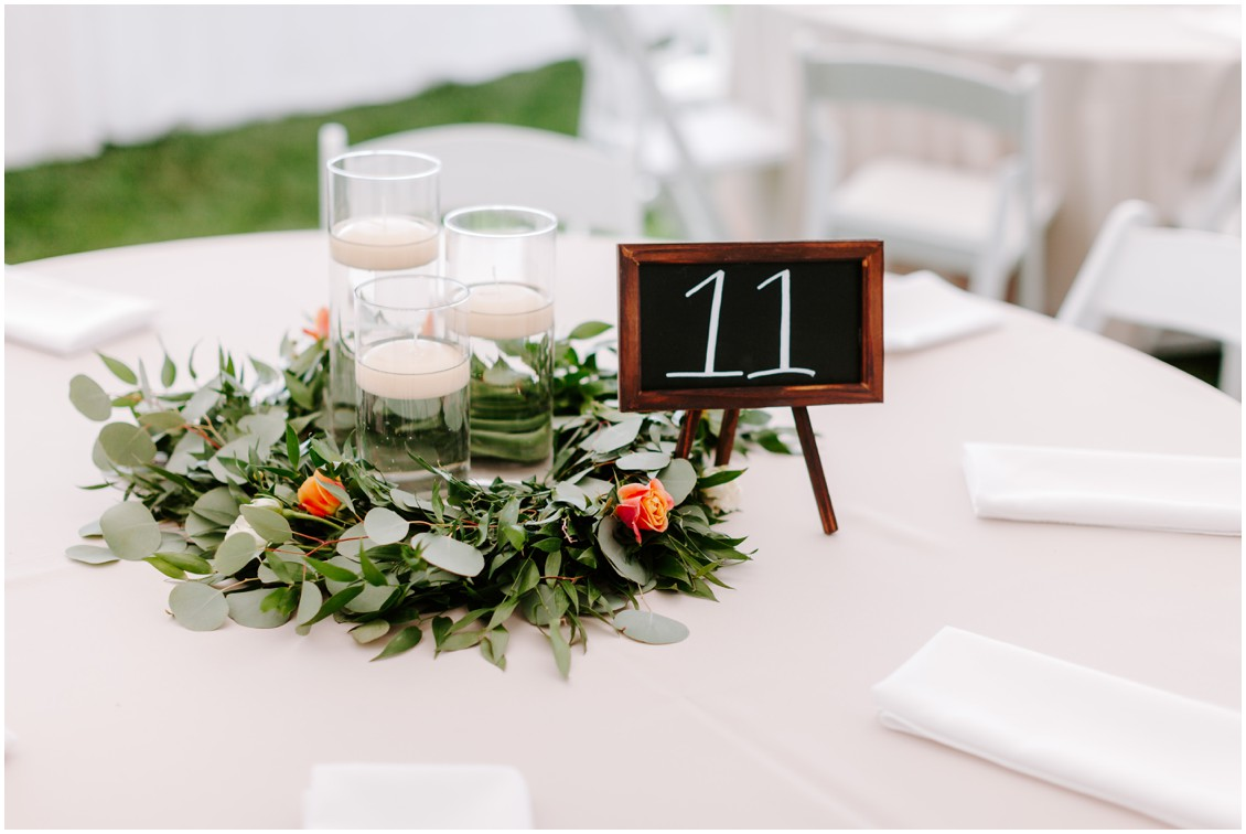 Detail of table arrangement with greenery, tea roses and floating candles | My Eastern Shore Wedding | Sherwood Florist | Eastern Shore Tents and Events