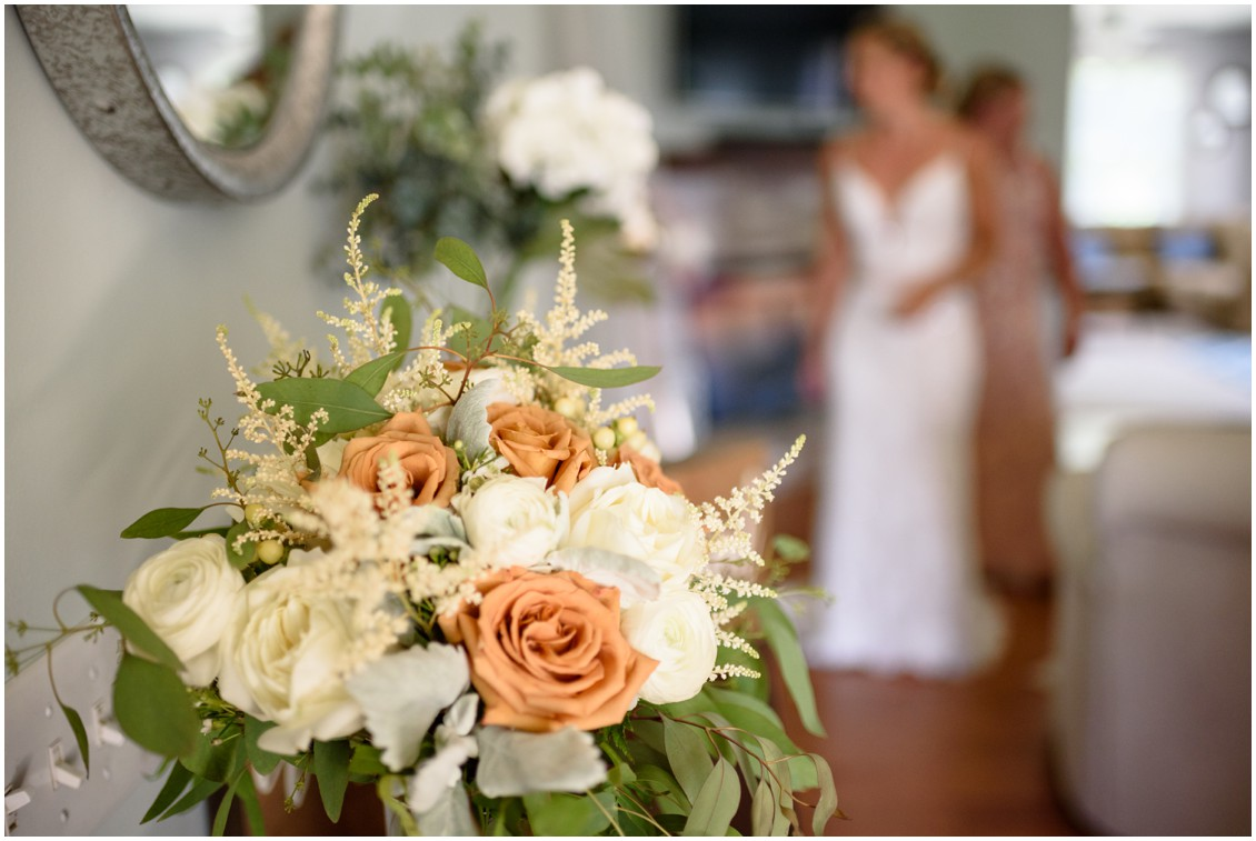 Bridal bouquet with bride out of focus in background | My Eastern Shore Wedding | J. Nicole Photography