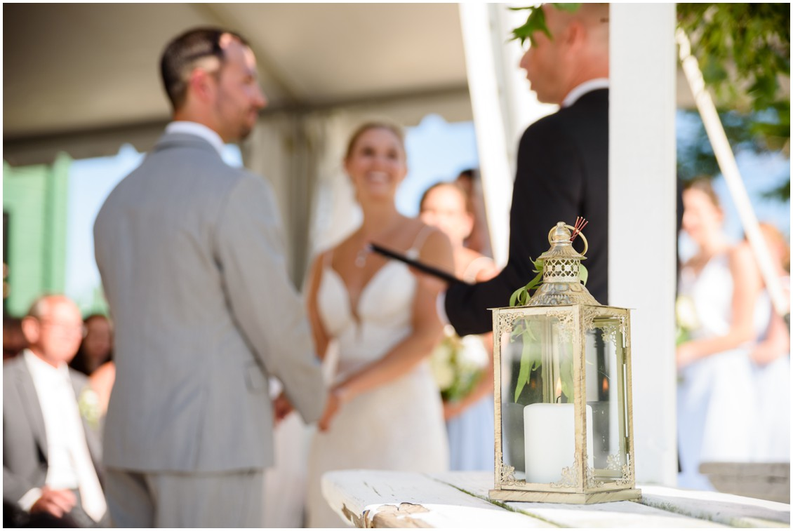 Bride and groom getting married under gazebo summertime soirée | My Eastern Shore Wedding | J. Nicole Photography