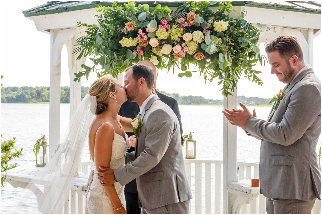 Bride and groom first kiss under gazebo at summertime soirée | My Eastern Shore Wedding | J. Nicole Photography