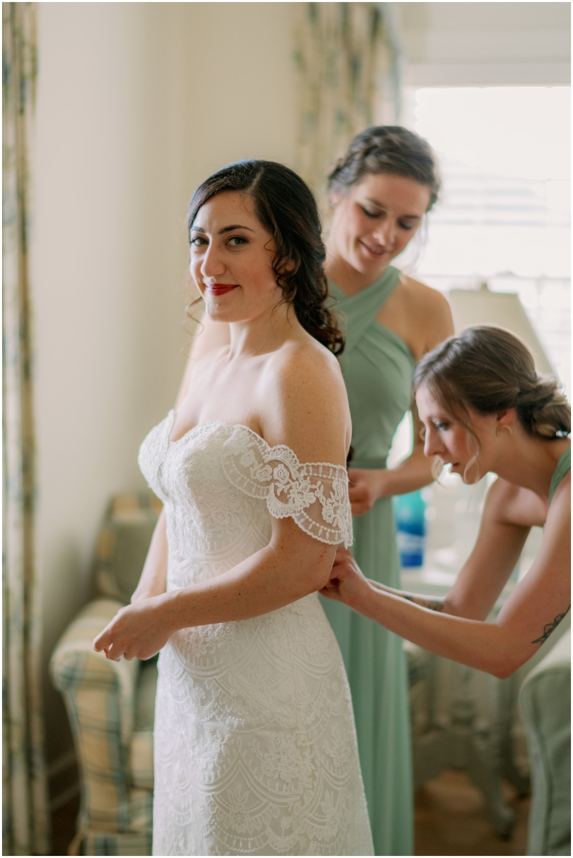 Bride in off the shoulder lace gown and red lip  | My Eastern Shore Wedding | The Oaks Waterfront Inn |