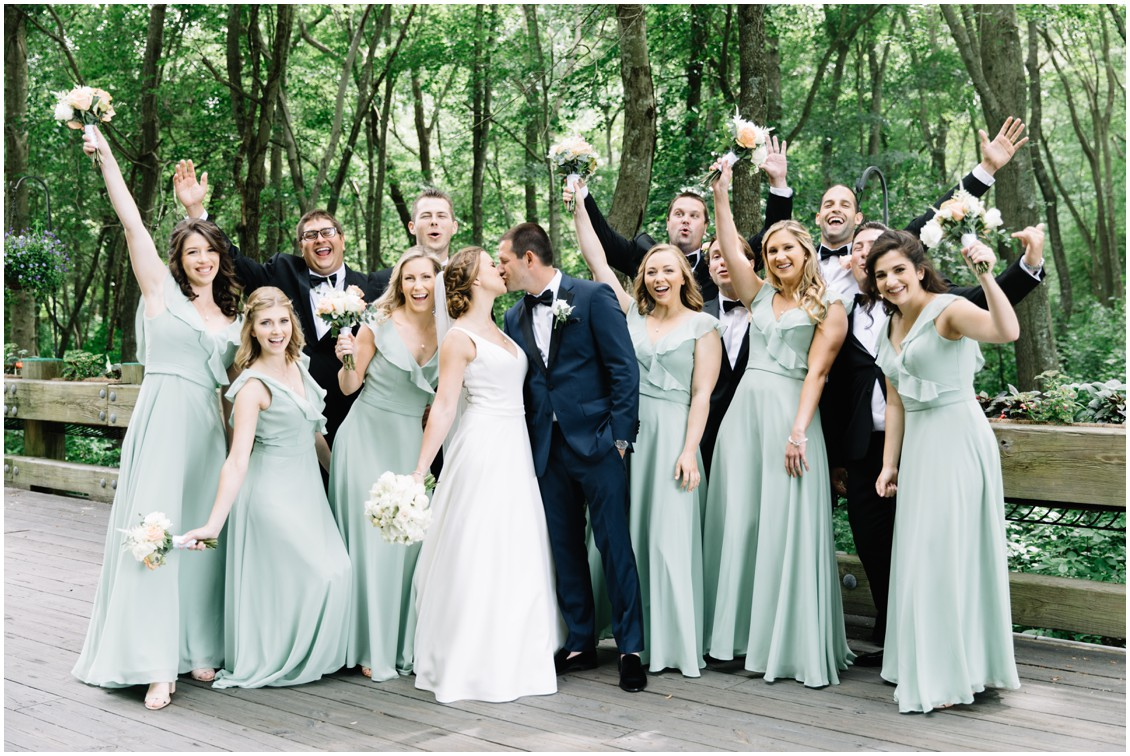 Bridal party with bride and groom soft green bridesmaid dresses | My Eastern Shore Wedding | The Clubhouse at Baywood