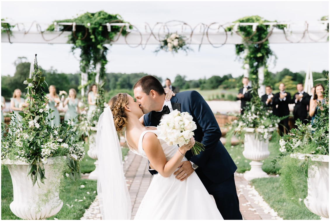 Abundant beauty at Baywood bride and groom kissing | My Eastern Shore Wedding | The Clubhouse at Baywood