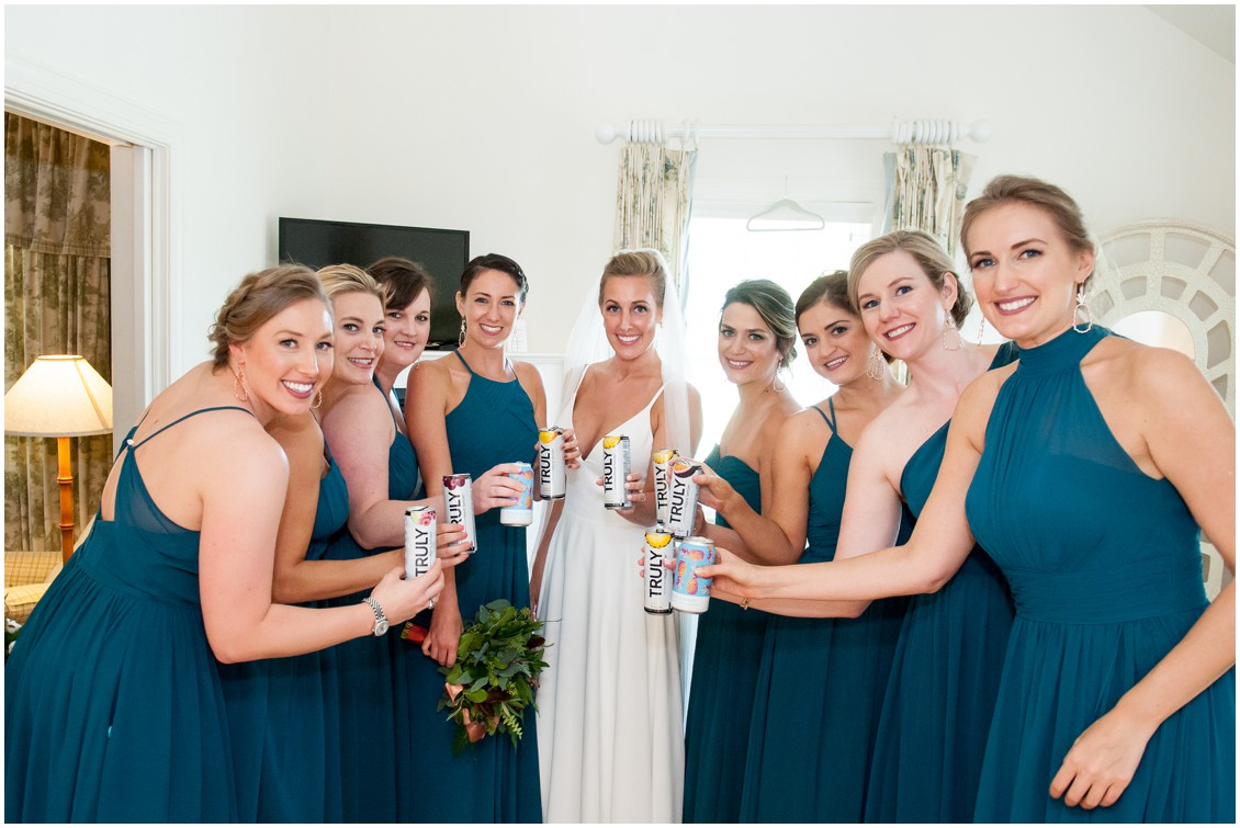 Bride with bridesmaids in teal dresses drinking pineapple Truly | My Eastern Shore Wedding | The Oaks Waterfront Inn | Monteray Farms