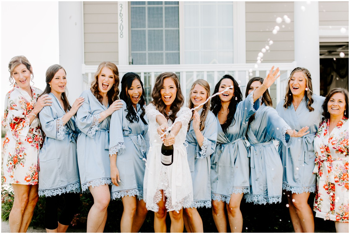 Bride and bridesmaids with champagne | My Eastern Shore Wedding | Bayside Resort
