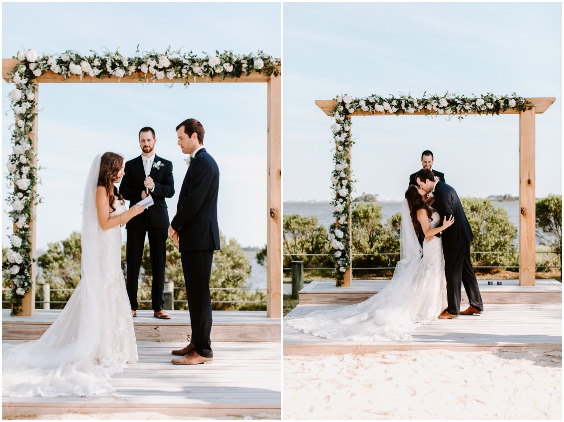 Bride and groom under floral arch during ceremony small wedding with a lot of heart | My Eastern Shore Wedding | Bayside Resort
