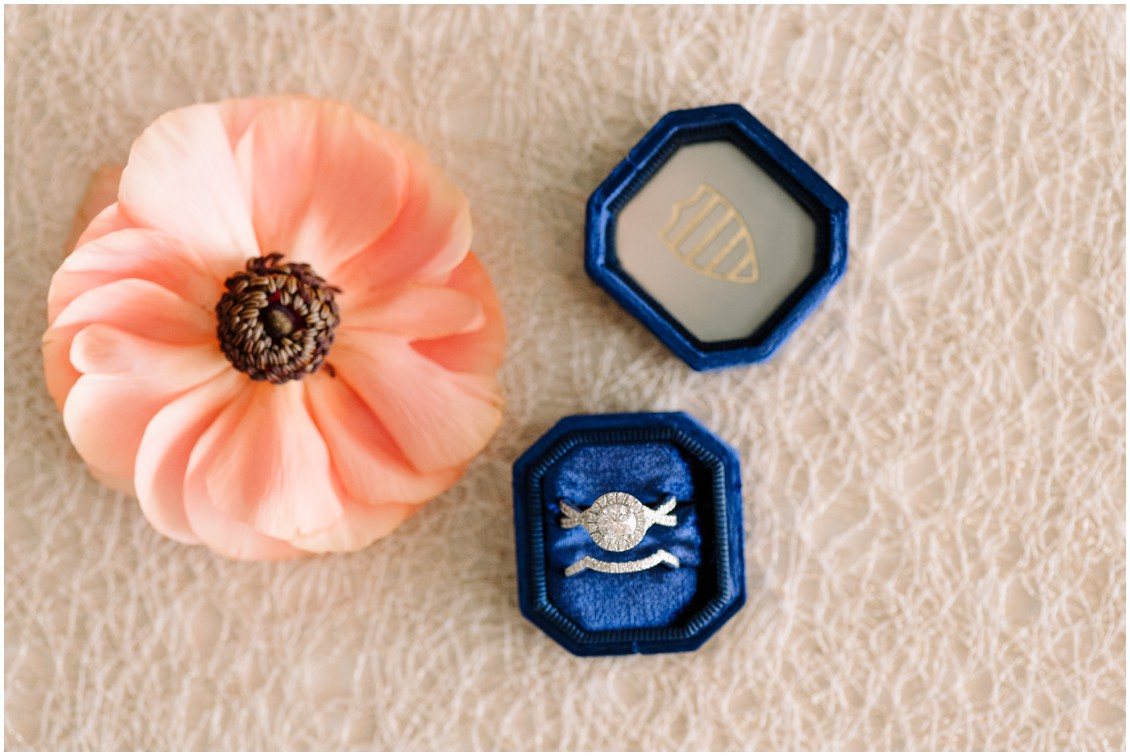 Detail shot of bright bouquet flowers and dark blue ring box bayside celebration | My Eastern Shore Wedding | Chesapeake Bay Beach Club