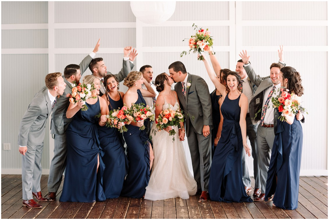 Bride and groom with bright bouquets and wedding party bayside celebration | My Eastern Shore Wedding | Chesapeake Bay Beach Club