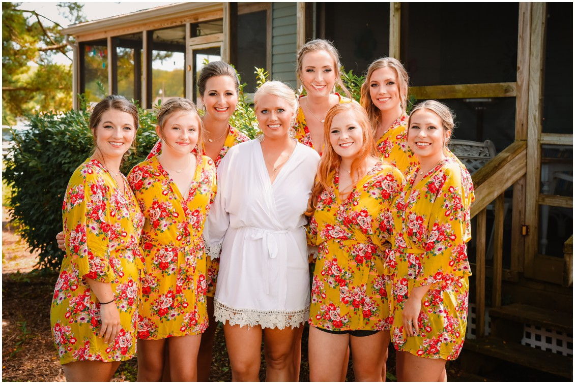 Bride and bridesmaids in sunny yellow robes, summer wedding | My Eastern Shore Wedding