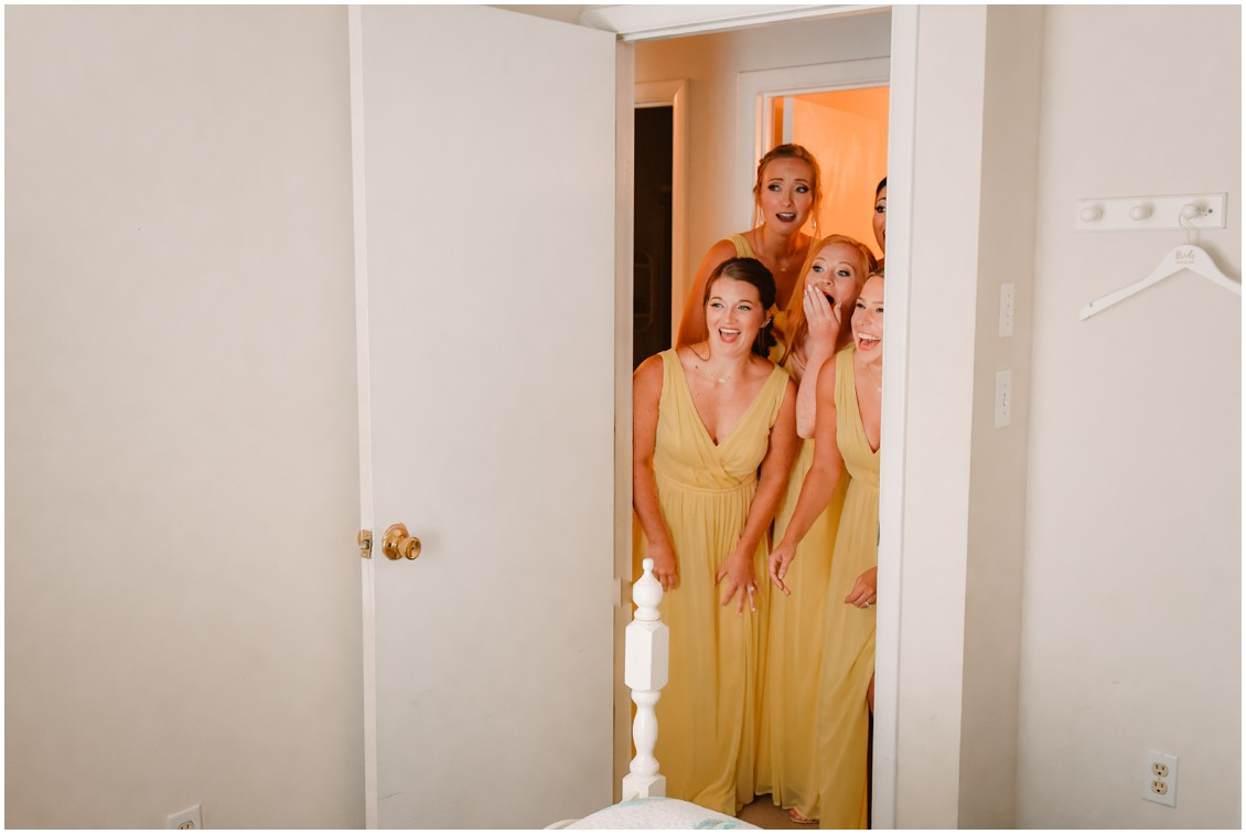 Bridesmaids in yellow dresses first look at bride | My Eastern Shore Wedding