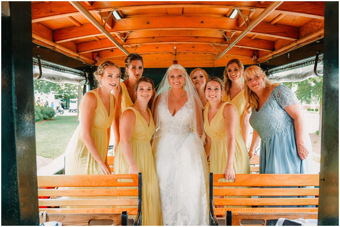 Bride and Bridesmaids on Jolly Trolley at sunny summer wedding | My Eastern Shore Wedding