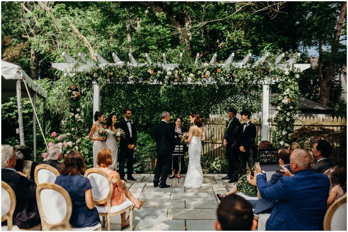 Bride and groom ceremony under floral arch | My Eastern Shore Wedding | Sherwood Florist