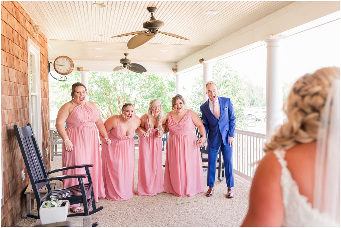 Bride and bridesmaids first look, pink and blue barn wedding | My Eastern Shore Wedding | Cassidy Mister Photography | East Vintage Charm