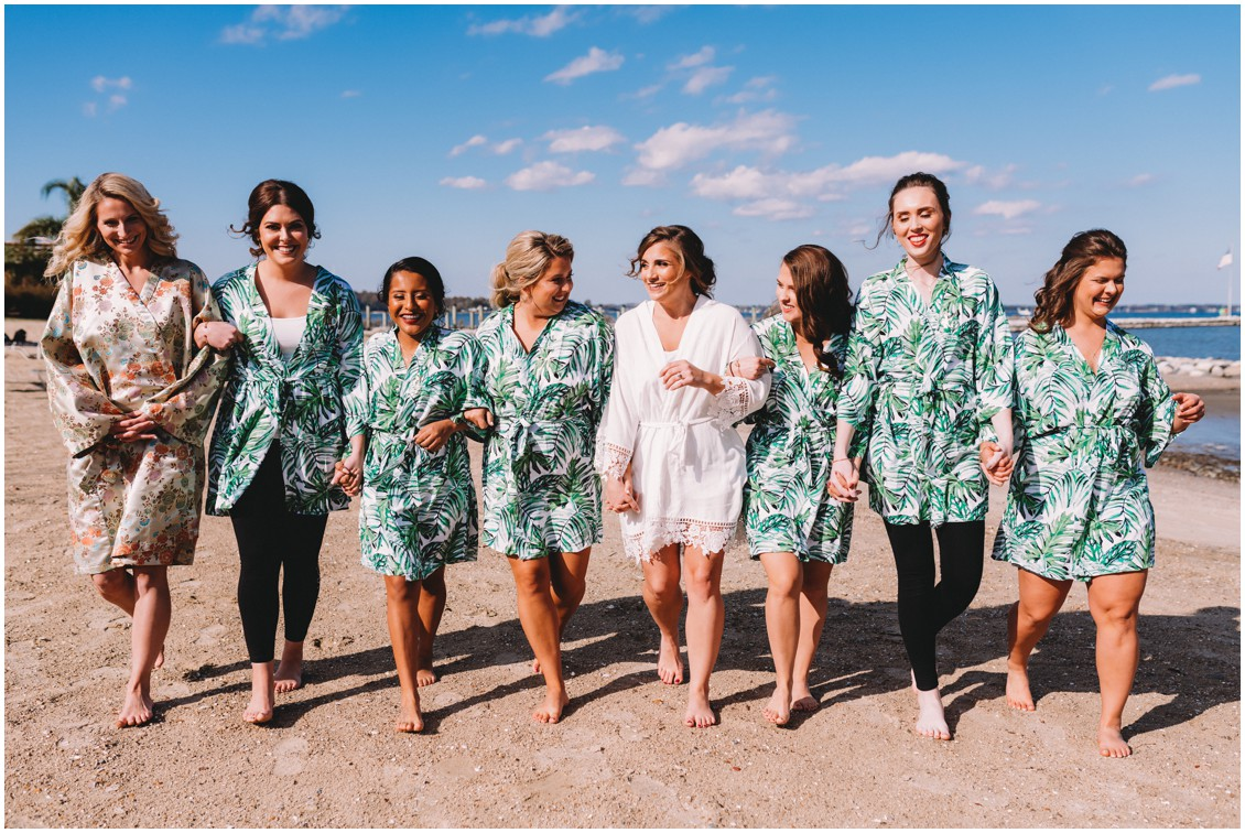 Bride with bridesmaids on beach getting ready| My Eastern Shore Wedding | Sherwood Florist