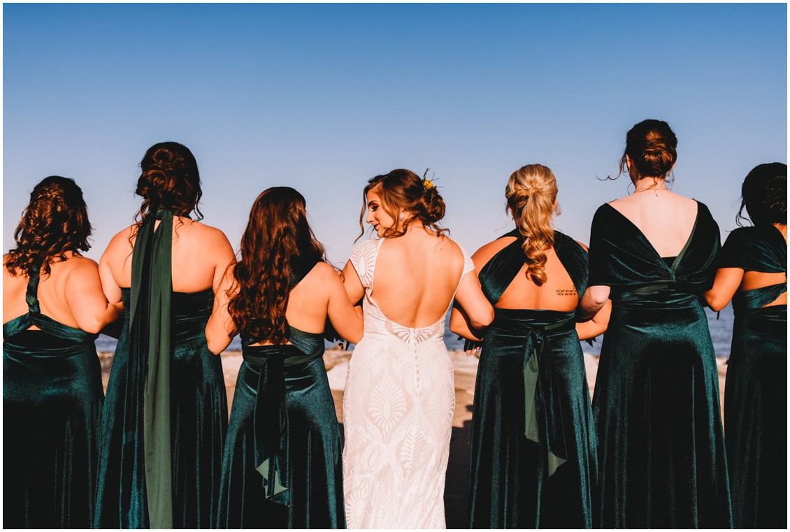 Bride with bridesmaids in bold green velvet dresses | My Eastern Shore Wedding | Sherwood Florist
