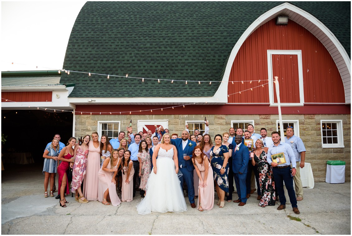 bride and groom with all wedding guests happily ever after | My Eastern Shore Wedding | J Nicole Photography