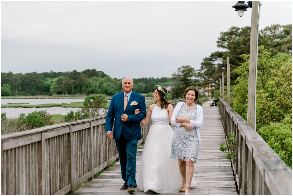 Bride walking down aisle/pier with parents small fall wedding | My Eastern Shore Wedding | Erin Wheeler Photography | Bayside Resort Golf Club
