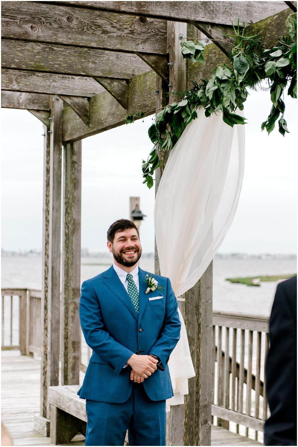 Groom first look naturally beautiful wedding | My Eastern Shore Wedding | Erin Wheeler Photography | Bayside Resort Golf Club