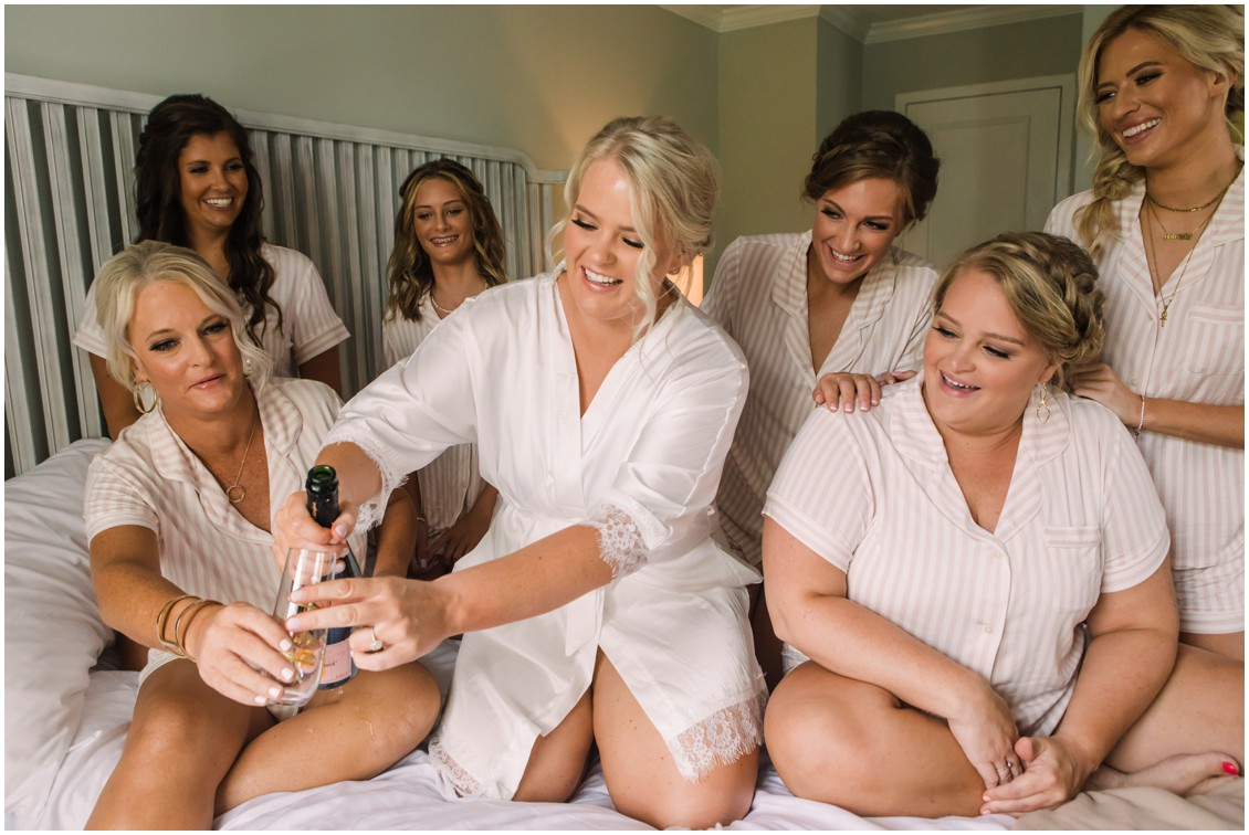 Bride with bridesmaids drinking blush bubbly | My Eastern Shore Wedding | J. Starr's Flower Barn | Laura's Focus Photography