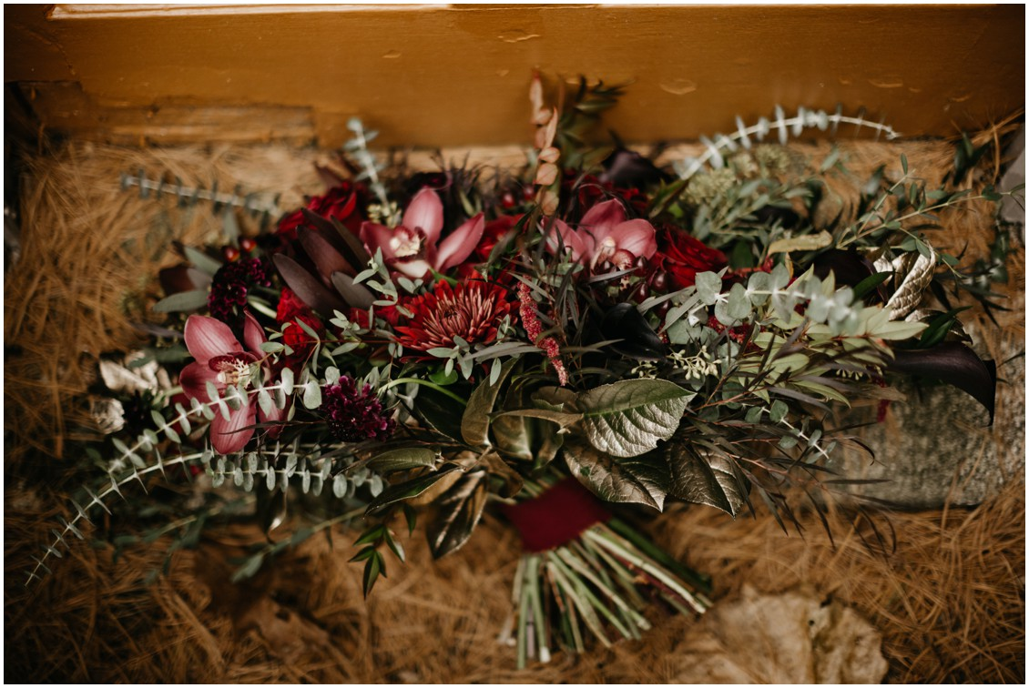 Moody hues bridal bouquet in red and burgundy | My Eastern Shore Wedding | J Starr's Flower Barn