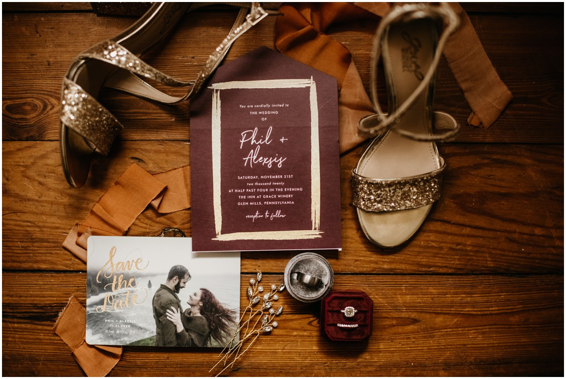 Flat lay of wedding details in moody red colors | My Eastern Shore Wedding | J Starr's Flower Barn  | My Eastern Shore Wedding | J Starr's Flower Barn