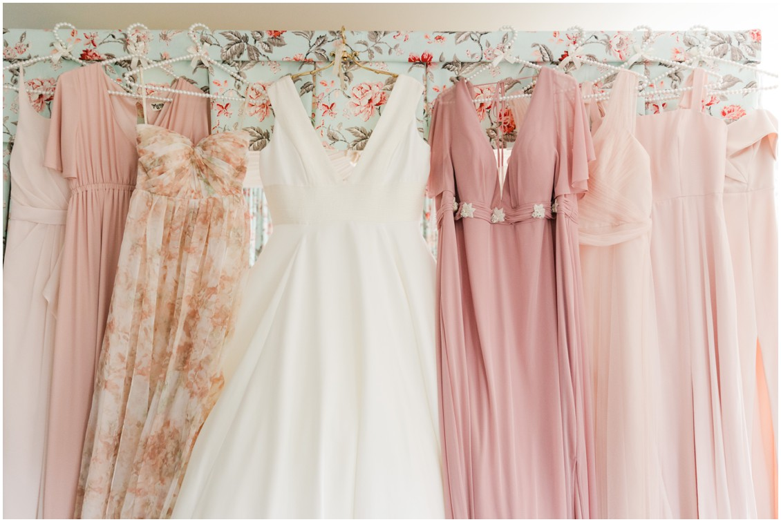 Bridal gown and mismatched bridesmaids dresses in shades of pink glam winter wedding | My Eastern Shore Wedding | Sherwood Florist