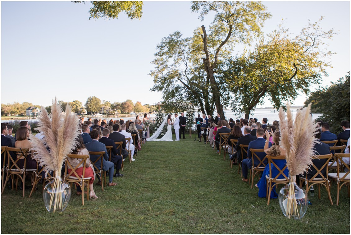 Wedding ceremony under gorgeous floral arch neutral flowers with pampas grass details  | My Eastern Shore Wedding | J Starr's Flower Barn