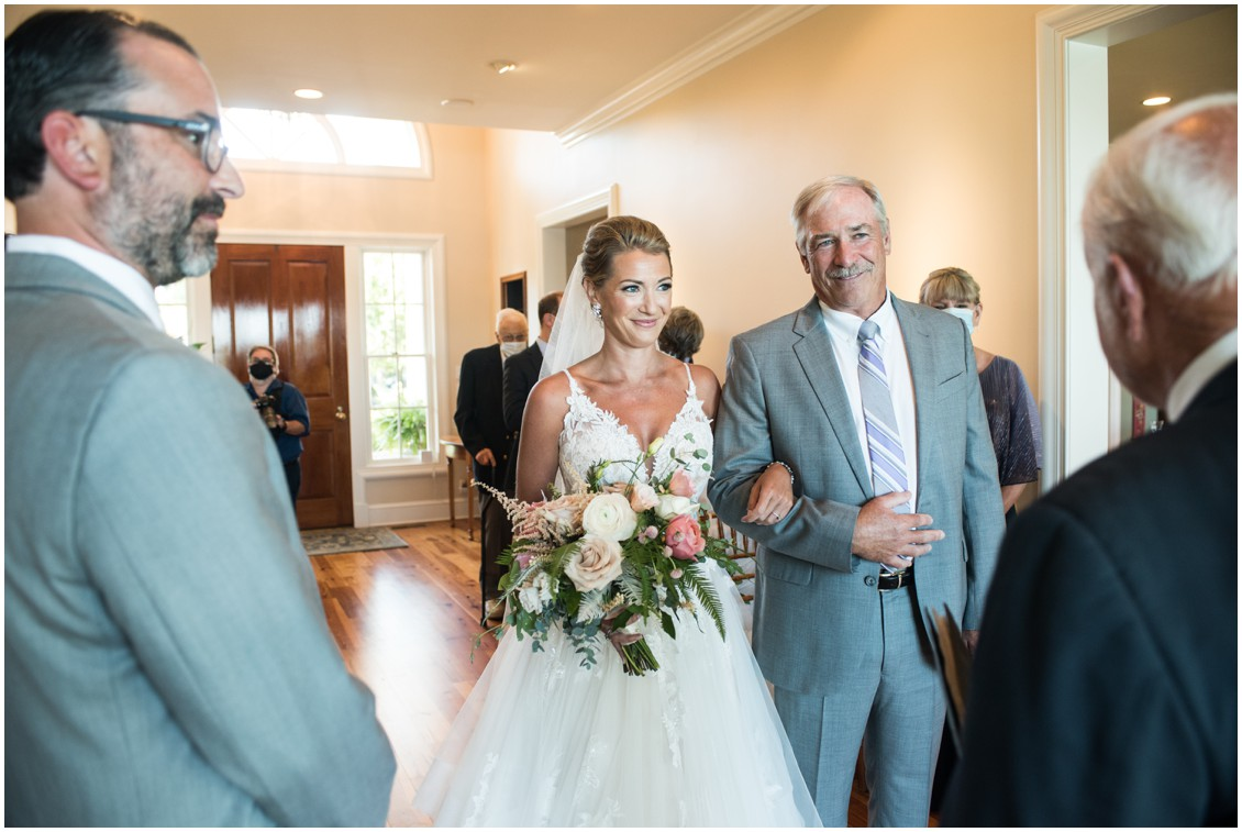 Bride walking up aisle with dad at elegant and intimate at-home wedding | My Eastern Shore Wedding | Melissa Grimes-Guy Photography | Beginning Memories