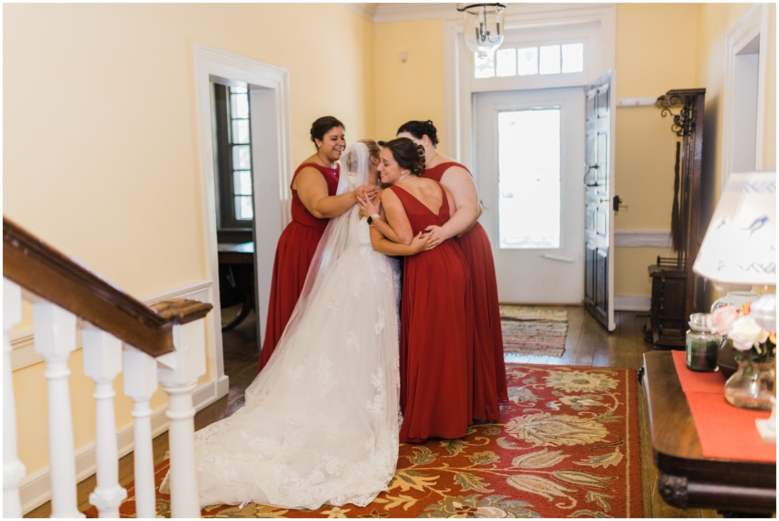 Bride with bridesmaids in group hug getting ready at  sweet as pie DIY Worsell Manor Wedding | My Eastern Shore Wedding