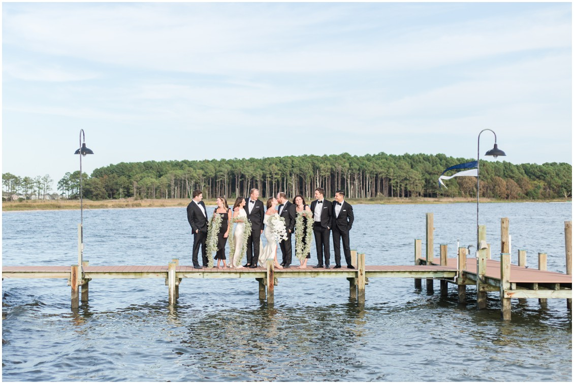 Bridal party on a dock at chic black tie beachside wedding | My Eastern Shore Wedding