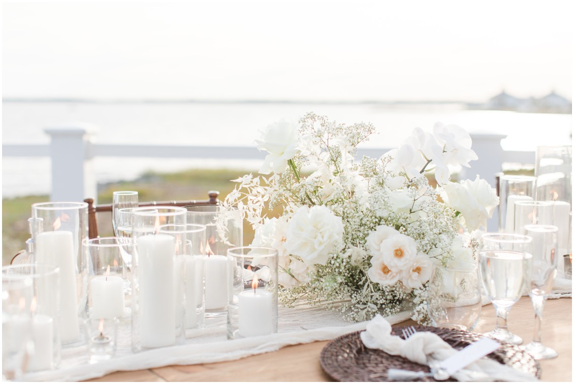 Details of table settings and decadent white florals at chic black tie beachside wedding | My Eastern Shore Wedding