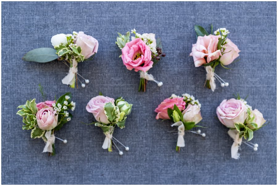 Pretty floral boutonnieres for the groom and groomsmen. Gorgeous and Rustic Barn Wedding